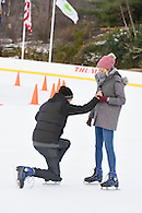 Guy on his knees proposing to his girlfriend.