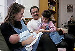 Berkeley CA Nuclear family, Latino father, daughter four-years-old admiring newborn brother  MR