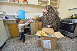 Huda Ismail, a single mother of three in Amman, Jordan, unpacks a box of household supplies with help her 3-year old daughter Hiba. The box was provided by International Orthodox Christian Charities, a member of the ACT Alliance. IOCC supports Syrian refugee families in Jordan, as well as many poor Jordanian families that have been negatively impacted by rising rents and prices for basic commodities, the result of the influx of Syrians into the city.