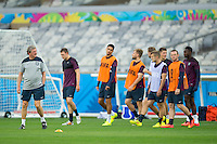 England manager Roy Hodgson leads out a dejected looking England team