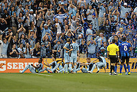 Sporting KC players form a train to celebrate their opening goal.<br /> Montreal Impact defeated Sporting Kansas City 2-1 at Sporting Park, Kansas City, Kansas.