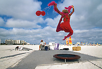 A model leaps into the air as a part of a photo shoot on South Beach, Miami.