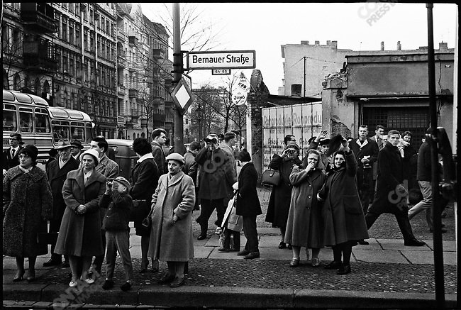 West Berliners watch construction of the Berlin Wall, Bernauer Strasse, West Berlin, Germany, November 1961