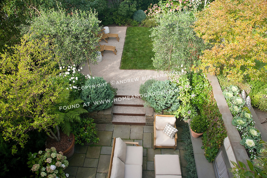 An overhead view of the lower fireplace area patio and the middle lawn area in this multi-level Seattle backyard.  Design by Scot Eckley, Inc.