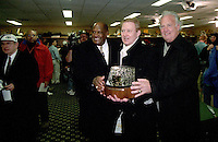 """Green Bay Packer Hall of Famers Willie Davis, left, and Paul Hornung, right, pose for a photo with Packers General Manager Bob Harlan and the George Halas Trophy at the conclusion of the NFC Championship against the Carolina Panthers on January 12, 1997. This was the first title game in Green Bay since the """"Ice Bowl"""" in 1967."""