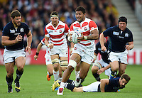 Amanaki Mafi of Japan in possession. Rugby World Cup Pool B match between Scotland and Japan on September 23, 2015 at Kingsholm Stadium in Gloucester, England. Photo by: Patrick Khachfe / Onside Images