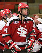 Nic Vangog (St. Lawrence - 14) - The Harvard University Crimson defeated the St. Lawrence University Saints 4-3 on senior night Saturday, February 26, 2011, at Bright Hockey Center in Cambridge, Massachusetts.