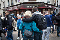 FRANCE, Paris: hundreds of people are ghatering in front of the Petit Cambodge restaurant and the Carillon restaurant where 12 people got killed during a terrorist attack on the 13th November 2015. Some flowers, candles and words have been dropped off in front of the entrance.
