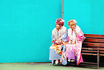 Twenty-year-old Japanese women wearing kimono take a break for a smoke during a ceremony held for Coming-of-Age Day at an amusement park in Tokyo, Japan. While Japanese women can marry as early as 16 years of age and men at 18, neither is considered to reach adulthood until they reach 20, when they can also legally begin to smoke, drink and vote.