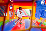 Kids enjoy inflatables and other games in the Employee Fun Zone area before the season opener against North Carolina Central University. Duke won the game 49-6 at the newly renovated Brooks Field at Wallace Wade Stadium.