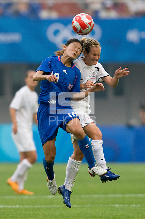 Japanese captain (10) Homare Sawa goes up for a header with New Zealand midfielder (4) Katie Hoyle during first round play in the 2008 Beijing Olympics at Qinhuangdao, China. .  Japan tied New Zealand, 2-2, at Qinhuangdao Stadium.
