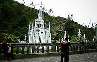 A soldiers gets a picture with Las Lajas Sanctuary (Santuario de Las Lajas) which is a basilica church located in the southern Department of Nariño and built inside the canyon of the Guáitara River. 1/7/2007. Photo by Joana Toro / VIEWpress.