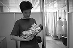 The Peoples Republic of China. Shanghai. 2000.  A father holds his newborn baby boy in the Shanghai Medical Obstetrics and Gynaecological Hospital. Deng Xiaoping introduced the ?one child? policy in 1979 - a complete reversal of Mao Zedung?s policy that had promoted large families. Although accurate statistics are hard to come by, the current estimate of 117 male to 100 female births mean that in twenty years time this little boy will find getting a girlfriend is hard work..