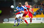 St Johnstone v Ross County...17.11.12      SPL.Gregory Tade is tackled by Grant Munro.Picture by Graeme Hart..Copyright Perthshire Picture Agency.Tel: 01738 623350  Mobile: 07990 594431
