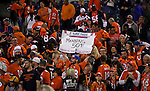 SHOT 10/19/14 8:41:56 PM - Denver Broncos fans celebrate Peyton Manning's 509th career passing touchdown against the San Francisco 49ers at Sports Authority Field at Mile High Sunday October 19, 2014 in Denver, Co. The Broncos beat the 49ers 42-17. Manning broke the all time passing touchdowns record in the game surpassing the previous mark of 509 by Brett Favre.<br /> (Photo by Marc Piscotty / &copy; 2014)