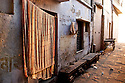 Morning light streams down an alleyway, or gulley, along the Ganges River in Varanasi, India.