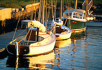 USA, Newport RI,- Sailboats docked at the Newport Yacht Museum in the late afternoon sun..