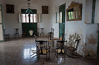 Room with colonial antique furniture  in the main building at Hacienda Yaxcopoil, Yucatan, Mexico.