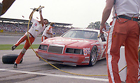 Joey Knuckles Cale Yarborough pits pit stop 3rd place finish Winston 500 at Alabama International Motor Speedway in Talladega , AL on May 5, 1985. (Photo by Brian Cleary/www.bcpix.com)