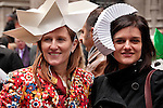 Two men wear hats made out of paper to the Easter Day Parade in New York City on Fifth Avenue