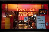 Halal food restaurant window on Manhattan. Sanitary inspection A grade.