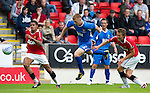 St Johnstone v Man Utd XI....31.07.10  Alan Main Testimonial.Liam Caddis is sent flying by Magnus Eikrem.Picture by Graeme Hart..Copyright Perthshire Picture Agency.Tel: 01738 623350  Mobile: 07990 594431