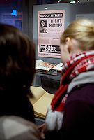 DEU, Deutschland, Germany, Berlin, 15.10.2010.Visiter in front of a book Mein Kampf by Adolf Hitler at the exhibition Hitler and the Germans Nation and Crime, Hitler und die Deutschen Volksgemeinschaft und Verbrechen, at the Deutsche Historische Museum, German Historical Museum, in Berlin, Germany. The new exhibition opening in Berlin has Adolf Hitler as its focus for the first time. It seeks to answer the question of why so many Germans chose to follow Hitler and his fascist ideology and so devotedly despite the horrors of World War II and the Holocaust. Exhibition hitler and the Germans. Exhibition, culture, cultural, visitor, visitors,  work of art, art, europe, exhibitions, exposition, expositions, geman, show, German, Germany, Europe, 2010, Event, Politics, Adolf Hitler, Fascism, Nazism, Arts Culture and Entertainment, display..[(c) Stefan Boness/Ipon - Veroeffentlichung nur gegen Honorar (zuzuegl. MwSt.), Namensnennung und Beleg; Kto.: 940165350, Bln. Spk., BLZ 100 500 00; Claudiusstr. 6, 10557 Bln, Phone: ++49-(0)30-3934318, www.iponphoto.com, e-mail: boness@iponphoto.com; No Model Release. Vereinbarungen ueber Model Release / Abtretung von Persoenlichkeitsrechten der abgebildeten Person/Personen liegen nicht vor.]