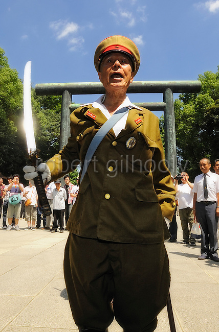 An unnamed man dressed in military garb marches to offer prayer at Yasukuni Shrine in Tokyo on Saturday 15 Aug. 2009. Wartime prime minister Hideki Tojo is enshrined inside the controversial shrine together with 13 other convicted war criminals. Aug. 15 marks the 64th anniversary of Japan's surrender in the Pacific War.