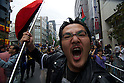 October 15, 2011, Tokyo, Japan - A protester screams during a Occupy Tokyo protest as it makes it's way through the streets of Shinjuku. Around 500 protesters took part in 3 separate protests in support of the Occupy Tokyo movement. The protesters airing a series of issues including Anti-Nuclear, Anti-Capitalism and Anti-TPP. They chanted '1% no thank you' and ' Nuclear no thank you ' at the rallies. Protesters in the Roppongi's Mikawadai Park numbered about 60 and were out numbered by around 70 Police and 40 members of the media. (Photo by Bruce Meyer-Kenny/AFLO) [3692]