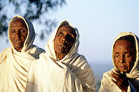 Eritrea. Southern Debud Zone  Maiado.  Small village in the country. Old women dressed in white cotton loinclothes pray  early in the morning (just after sunrise) at a religious service in the orthodox church .  © 2002 Didier Ruef