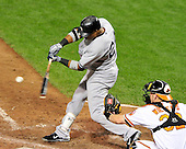 New York Yankees second baseman Robinson Cano (24) singles in the ninth inning against the Baltimore Orioles at Oriole Park at Camden Yards in Baltimore, Maryland on Monday, August 29, 2011.  The Yankees won the game 3 - 2..Credit: Ron Sachs / CNP.(RESTRICTION: NO New York or New Jersey Newspapers or newspapers within a 75 mile radius of New York City)