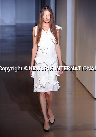 "JIL SANDER.Women's Wear Spring/Summer 2010 Collection, Milan Fashion Week, Milano_28/09/2009.Mandatory Credit Photo: ©NEWSPIX INTERNATIONAL..**ALL FEES PAYABLE TO: ""NEWSPIX INTERNATIONAL""**..IMMEDIATE CONFIRMATION OF USAGE REQUIRED:.Newspix International, 31 Chinnery Hill, Bishop's Stortford, ENGLAND CM23 3PS.Tel:+441279 324672  ; Fax: +441279656877.Mobile:  07775681153.e-mail: info@newspixinternational.co.uk"
