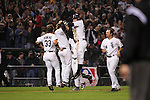 CHICAGO - OCTOBER 12:   The White Sox celebrate after Joe Crede hit a two out double in the bottom of the 9th inning during Game 2 of the American League Championship Series against the Los Angeles Angels of Anahiem at U.S. Cellular Field on October 12, 2005 in Chicago, Illinois.   Crede knocked in Pable Ozuna to give the White Sox the victory.  The White Sox defeated the Angels 2-1.