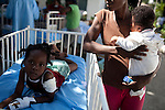 Patients are treated outside in the courtyard at the St. Francois De Sales hospital in Port-au-Prince, Haiti. The hospital's main building collapsed in the recent earthquake.