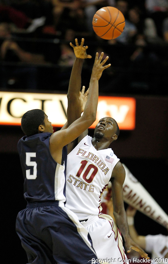 TALLAHASSEE, FL 11/12/10-FSU-ASU MBB 111210 CH-Florida State's Okaro White blocks the shot of North Florida's Charles McRoy during first half action Friday at the Donald L. Tucker Center in Tallahassee. .COLIN HACKLEY PHOTO
