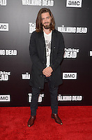 HOLLYWOOD, CA - OCTOBER 23: Tom Payne at AMC Presents Live, 90-Minute Special Edition of 'Talking Dead' at Hollywood Forever on October 23, 2016 in Hollywood, California. Credit: David Edwards/MediaPunch