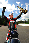 May 6, 2012; Commerce, GA, USA: NHRA pro stock motorcycle rider Eddie Krawiec celebrates after winning the Southern Nationals at Atlanta Dragway. Mandatory Credit: Mark J. Rebilas-