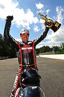 May 6, 2012; Commerce, GA, USA: NHRA pro stock motorcycle rider Eddie Krawiec celebrates after winning the Southern Nationals at Atlanta Dragway. Mandatory Credit: Mark J. Rebilas-
