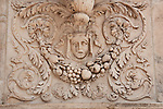 Detail on Duomo in Milan, Italy which is covered in sculptures and carved stone details