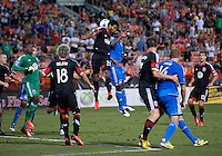 Lionard Pajoy (26) of D.C. United goes up for a header with Nana Attakora (23) of the San Jose Earthquakes during a Major League Soccer game at RFK Stadium in Washington, DC.  D.C. United defeated San Jose Earthquakes, 1-0.