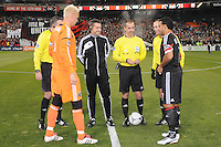 MLS referee Mark Geiger with Sporting Kansas City captain Jimmy Nielsen and D.C. United captain Dwayne De Rosario during the coin toss.  Sporting Kansas City defeated D.C. United  1-0 at RFK Stadium, Saturday March 10, 2012.