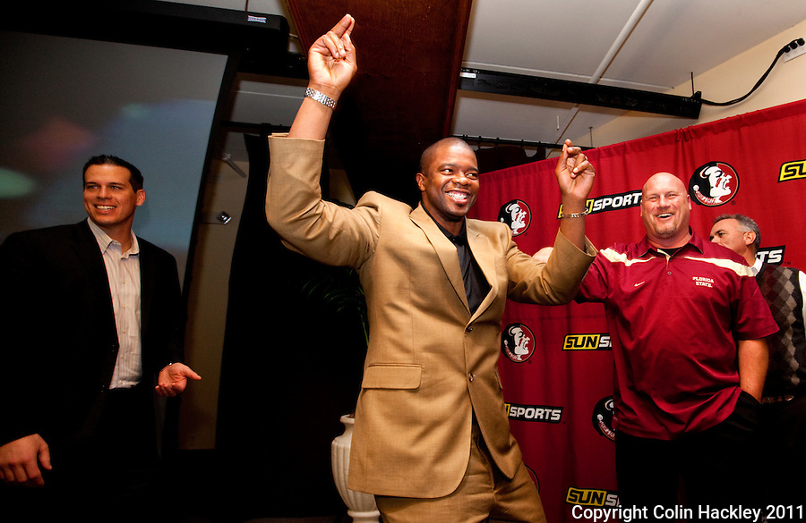 TALLAHASSEE, FLA. 2/2/11-FSUSIGN020211CH-Quarterbacks Coach Dameyune Craig, center, Defensive Ends Coach D.J. Elliot, left, and Linebackers Coach Greg Hudson share a laugh at the close of the 2011 national signing day war party in Tallahassee...COLIN HACKLEY PHOTO