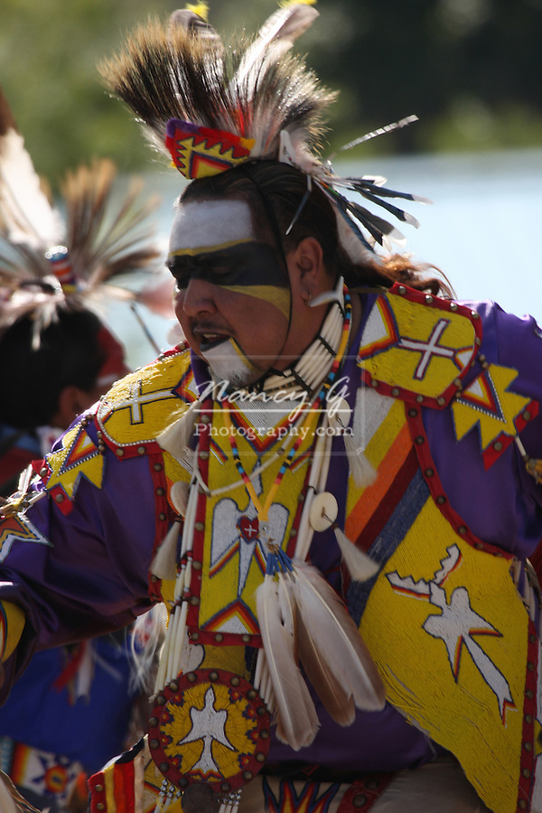 A mature male Native American Menomonee Indian dancing fast at a Pow Wow at the Milwaukee Lakefront Indian Summer Festival, Wisconsin