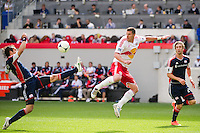 A.J. Soares (5) of the New England Revolution clears a pass intended for Kenny Cooper (33) of the New York Red Bulls during the first half during a Major League Soccer (MLS) match at Red Bull Arena in Harrison, NJ, on April 28, 2012.