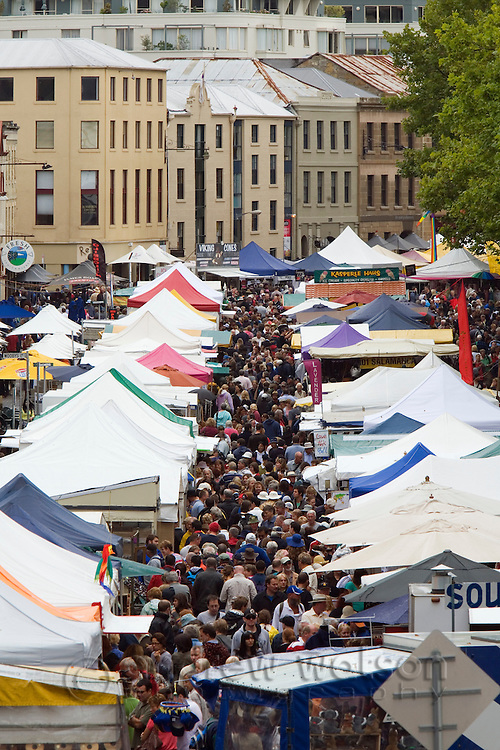 Crowds fill the Salamanca Market.  The weekly market, held in Salamanca Place, draws locals and tourists with its food and craft stalls.  Hobart, Tasmania, AUSTRALIA