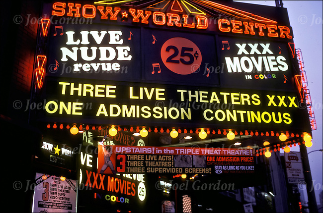 Live Nude Revue GOR 64748H Close up at night of adult theater marquee. Sex is everywhere in the ...