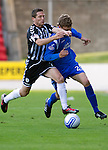 St Johnstone v St Mirren...11.09.10  .Murray Davidson gets a sore one from Hugh Murray.Picture by Graeme Hart..Copyright Perthshire Picture Agency.Tel: 01738 623350  Mobile: 07990 594431