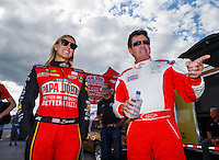 Sep 2, 2016; Clermont, IN, USA; Papa Johns pizza founder John Schnatter (right) with NHRA top fuel driver Leah Pritchett during qualifying for the US Nationals at Lucas Oil Raceway. Mandatory Credit: Mark J. Rebilas-USA TODAY Sports