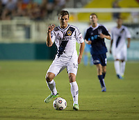 Robbie Rogers (14) of the LA Galaxy passes the ball during a third round match in the US Open Cup at WakeMed Soccer Park in Cary, NC.  The Carolina Railhawks defeated the LA Galaxy, 2-0.