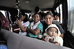 People crowd together in a bus in Victoria 20 de enero, a village of former Guatemalan refugees in Mexico who returned home as a group in 1993, while the country's bloody civil war still raged.